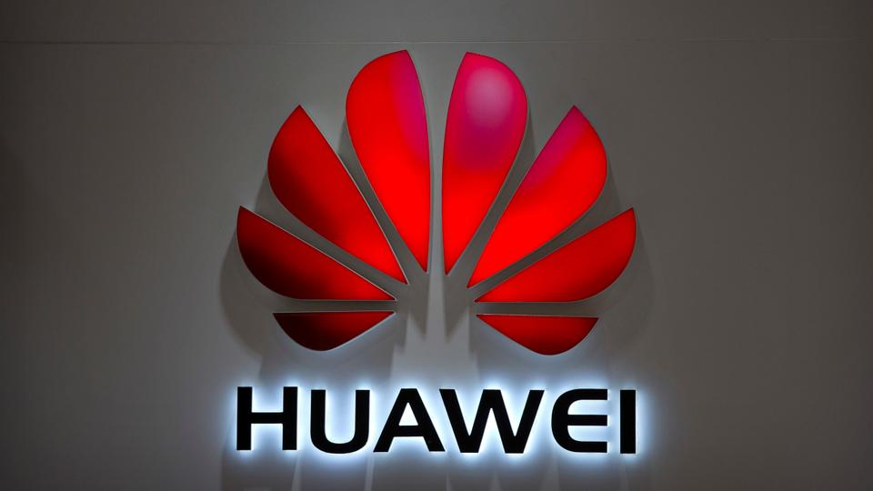 On July 4, 2018, the file photo Huawei logo can be seen at the Huawei store in a shopping mall in Beijing.