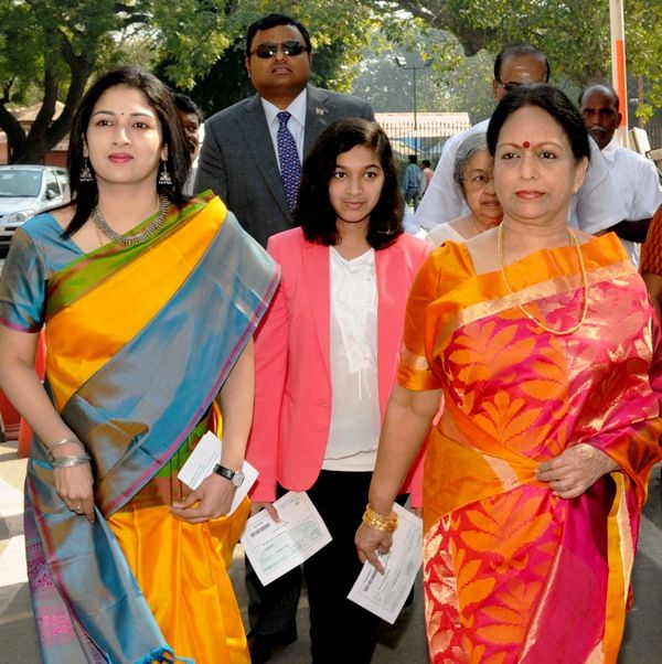 Karti Chidambaram with his mother (right), wife (left), daughter (center)