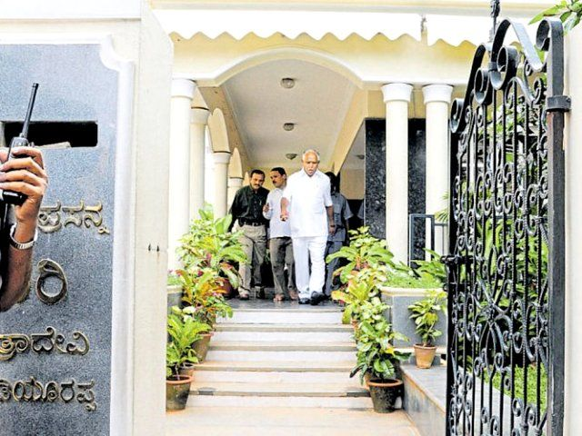 BS Yeddyurappa coming out of his house